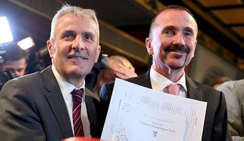 Karl Kreile, right, and Bodo Mende show the marriage document in Berlin, Sunday, Oct. 1, 2017.