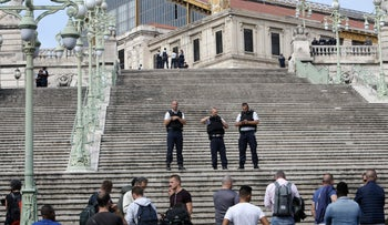 French security forces standing outside a train station in Marseille, France on Sunday October 1, 2017 after a man stabbed and killed two people. French forces have confirmed that the attacker has been shot and killed.