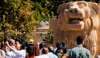 The General Directorate of Antiquities and Museums in Syria present the statue of the Lion of Al-Lat, which dates back to the first century AD, to the public after its restoration at the National Museum in Damascus on October 1, 2017.  The statue, which was destroyed by Islamic State (IS) group jihadists in July 2015 after they captured the ancient city of Palmyra, was restored by the Polish restorer Bartoz Bartopar under the funding of the Office of the United Nations Educational, Scientific and Cultural Organization UNESCO in Beirut.