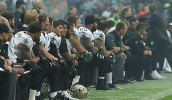 New Orleans Saints players kneel down before the U.S. national anthem was played ahead of an NFL football game against Miami Dolphins at Wembley Stadium in London, Sunday Oct. 1, 2017