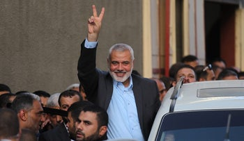 Hamas's leader Ismail Haniya waves as he arrives for a meeting  with Palestinian prime minister in Gaza City, October 2, 2017.
