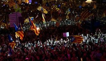 People cheer and wave esteledas, or Catalonia independence flags, during the 'Yes' vote closing campaign in Barcelona, Spain, Friday, Sept. 29, 2017. Catalonia's planned referendum on secession is due be held Sunday by the pro-independence Catalan government but Spain's government calls the vote illegal, since it violates the constitution, and the country's Constitutional Court has ordered it suspended. (AP Photo/Francisco Seco)