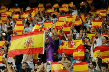 Real Madrid fans display Spanish national flags in support of a united Spain against the Catalonian referendum for independence during a Spanish La Liga soccer match between Real Madrid and Espanyol at the Santiago Bernabeu stadium in Madrid, Spain, Sunday, Oct. 1, 2017. (AP Photo/Paul White)