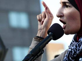 Activist Linda Sarsour speaks ahead of the March for Racial Justice in the Brooklyn borough of New York, U.S., on Sunday, Oct. 1, 2017. The March for Racial Justice is a multi-community movement organized to protest against systemic racism and promote civil rights for all. Photographer: Yana Paskova/Bloomberg