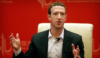File photo - Facebook CEO Mark Zuckerberg speaks during a panel discussion in Beijing in March, 2016.