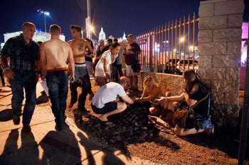 People tend to the after a shooting on October 1, 2017 in Las Vegas, Nevada.