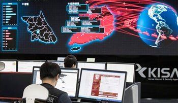 Employees watch electronic boards monitoring possible ransomware cyberattacks at the Korea Internet and Security Agency in Seoul, South Korea, May 15, 2017.