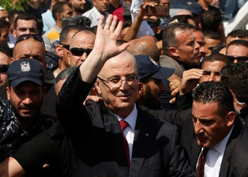 Palestinian Prime Minister Rami Hamdallah waves upon his arrival with his government ministers to take control of Gaza from the Islamist Hamas group, in the northern Gaza Strip October 2, 2017