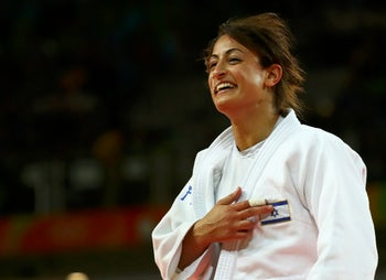Yarden Gerbi celebrates after securing the bronze medal in Judo at the Rio Olympics on Tuesday, August 09, 2016.