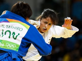 Israel's Yarden Gerbi, in white, competes against Japan's Miku Tashiro during the bronze-medal round of the women's 63-kg judo competition at at the 2016 Summer Olympics in Rio de Janeiro, Brazil, August 9, 2016.