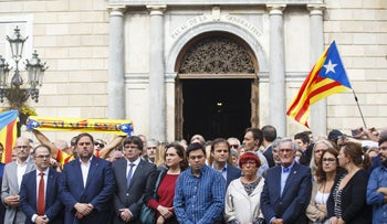 Catalan President Carles Puigdemont, fourth left, stands with regional leaders during a demonstration called by pro-independence groups in Barcelona, October 2, 2017.