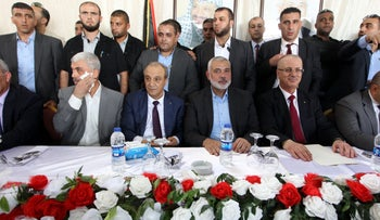 L-R: Yahya Sinwar, Majid Faraj, Ismail Haniyeh and Rami Hamdallah sit during a meeting in Gaza City October 2, 2017.