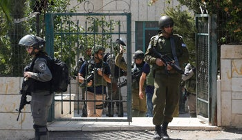 Israeli soldiers at Mahmoud's family home in the West Bank village of Beit Surik, Sept. 26, 2017