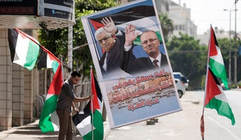 Palestinian flags and a poster of the Palestinian President Mahmoud Abbas and Prime Minister Rami Hamdallah in Gaza, Oct. 1, 2017.