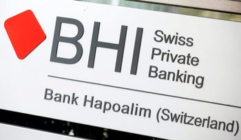 A sign sits outside Bank Hapoalim B.M. in Zurich, Switzerland, on Tuesday, Oct. 13, 2015.