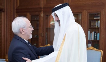 Emir of Qatar Sheikh Tamim bin Hamad al-Thani shakes hands with Iran's Foreign Minister Mohammad Javad Zarif during their meeting in Doha, Qatar October 3, 2017