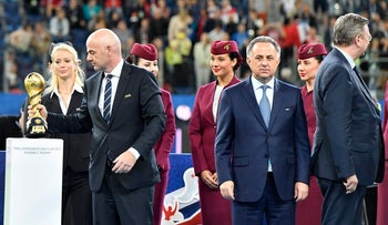 FIFA President Gianni Infantino, Russian Deputy-Prime minister and head of the World Cup 2018 organizing committee Vitaly Mutko and Reinhard Grindel, head of the German soccer federation after Germany won 1-0 in the Confederations Cup final soccer match between Chile and Germany at the St.Petersburg Stadium in Russia, Sunday July 2, 2017.
