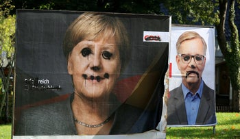 Defaced election campaign posters of Angela Merkel's Christian Democrats and the Left Party in  Altenberg, Germany, September 27, 2017.