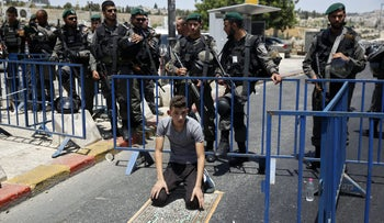 A Palestinian youth is seen at a checkpoint outside Jerusalem's Old City, July 28, 2017.
