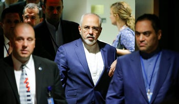 Iran's Foreign Minister Mohammad Javad Zarif (C) exits after a meeting of the parties to the Iran nuclear deal at UN headquarters in New York, September 20, 2017.