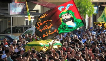 File photo: Hezbollah supporters carry the coffin of a Hezbollah commander killed in Syria, southern Lebanon, August 4, 2017.