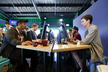 Attendees work in a coding lab during the Google I/O Annual Developers Conference in Mountain View, California, May 17, 2017.