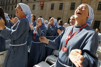 Nuns sing while waiting for Pope Benedict XVI at the Monastery of El Escorial in Madrid, August 19, 2011.