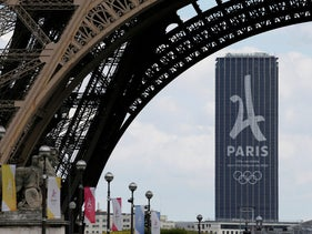 FILE PHOTO - The logo of the Paris candidacy for the 2024 Olympic and Paralympic Games is seen July 11, 2017 on the Montparnasse tower behind the Eiffel Tower in Paris, France. Picture taken July 11, 2017.  REUTERS/Gonzalo Fuentes/File Photo