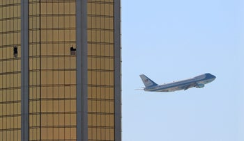 Air Force One departs Las Vegas past the broken windows on the Mandalay Bay hotel, where shooter Stephen Paddock conducted his mass shooting, October 4, 2017.