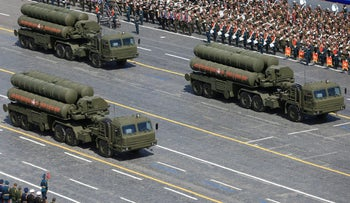 FILE PHOTO: Russian S-400 Triumph/SA-21 Growler medium-range and long-range surface-to-air missile systems drive during the Victory Day parade at Red Square in Moscow, Russia, May 9, 2015.