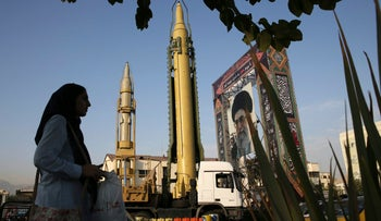 A Ghadr-H missle, center, a solid-fuel surface-to-surface Sejjil missile and a portrait of the Supreme Leader Ayatollah Ali Khamenei are on display for the annual Defense Week, marking the 37th anniversary of the 1980s Iran-Iraq war, at Baharestan Sq. in Tehran, Iran, Sunday, Sept. 24, 2017. Iran's elite Revolutionary Guard displayed the country's sophisticated Russian-made S-300 air defense system in public for the first time. (AP Photo/Vahid Salemi)