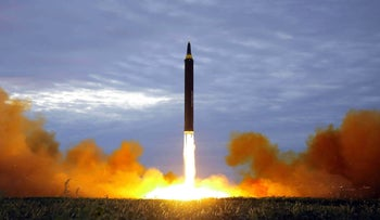 North Korea's intermediate-range strategic ballistic rocket Hwasong-12 lifting off from the launching pad at an undisclosed location near Pyongyang, August 29, 2017.