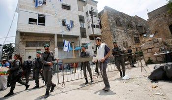 Israeli border police officers in front of a building in the West Bank city of Hebron, July 26, 2017.