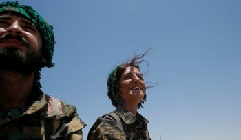 Kurdish fighters from the People's Protection Units (YPG) in a pick up vehicle in Raqqa, Syria, June 16, 2017.