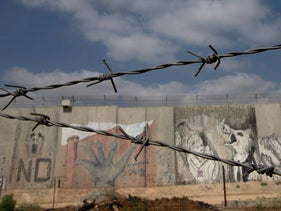 A section of the Israeli separation barrier that surrounds the West Bank city of Qalqilya on three sides. July 5, 2017