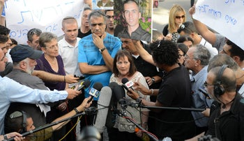 The families of Oron Shaul and Hadar Goldin hold a press conference across from the Prime Minister's Residence in Jerusalem, June 27, 2016.