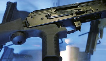 "A little-known device called a ""bump stock"" is attached to a semi-automatic rifle at the Gun Vault store and shooting range Wednesday, Oct. 4, 2017"