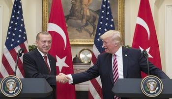 U.S. President Donald Trump shakes hands with Recep Tayyip Erdogan, Turkey's president, in the White House, May 16, 2017