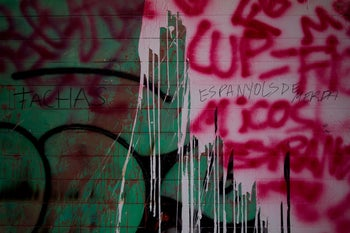 """The headquarters of the Catalan pro-independence party """"Candidatura d'Unitat Popular - CUP"""" (Popular Unity Candidacy) party in Barcelona was vandalized with graffiti reading """"Fascists"""". October 9, 2017"""