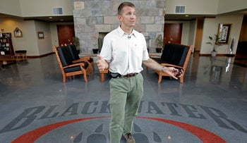 File photo: Founder and CEO of Blackwater Worldwide Erik Prince talks at Blackwater's offices in Moyock, North Carolina.