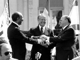 File photo: Egyptian President Anwar Sadat, U.S. President Jimmy Carter and Israeli Prime Minister Menachem Begin clasp hands at the White House after signing the peace treaty between Egypt and Israel