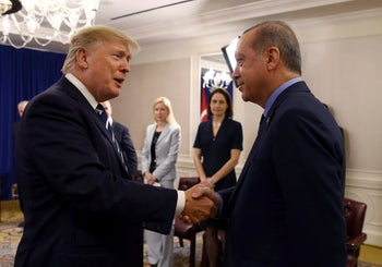 Turkey's President Recep Tayyip Erdogan, right, and US President Donald Trump shake hands prior to their meeting in New York, Thursday, Sept. 21, 2017.