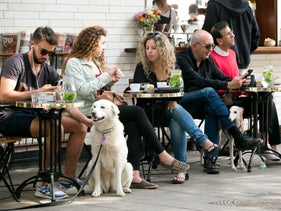 An illustrative image of people sitting at a street cafe in Tel Aviv.