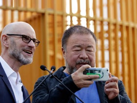 Chinese activist artist Ai Weiwei, right, and Chief Curator Nicholas Baume of the Public Art Fund, in New York's Central Park, October 10, 2017.