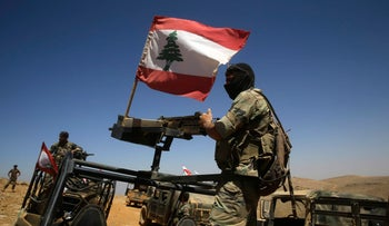 Lebanese soldiers sit on top of an armored personnel carrier during a media trip organized by the Lebanese army, on the outskirts of Ras Baalbek, northeast Lebanon, Monday, Aug. 28, 2017. (AP Photo/Hassan Ammar)