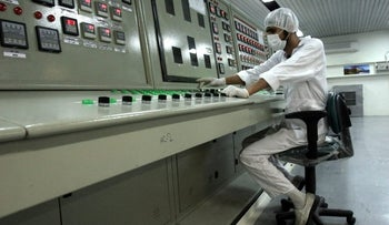 In this Saturday, Feb. 3, 2007 file photo, an Iranian technician works at the Uranium Conversion Facility just outside the city of Isfahan 255 miles (410 kilometers) south of the capital Tehran, Iran.