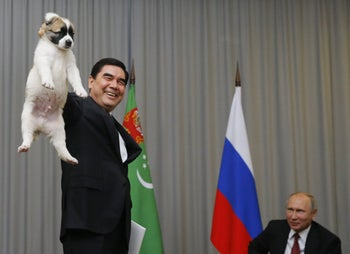 Turkmen President Gurbanguly Berdimuhamedov demonstrates a Turkmen shepherd dog before presenting it to his Russian counterpart Vladimir Putin in Sochi, Russia, October 11, 2017.