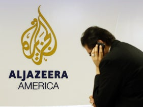 A man works at a desk in the Al Jazeera America broadcast center in New York, August 20, 2013.