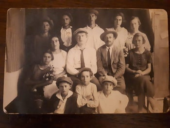 Dina Shmueli, sitting first on the right, in a photo from the Sejera school at the turn of the 20th century.