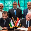 Fatah's Azam al-Ahmad (R)and Saleh al-Aruri of Hamas sign a reconciliation deal at the Egyptian intelligence services headquarters in Cairo on October 12, 2017, as the two movements ended their decade-long split following negotiations.